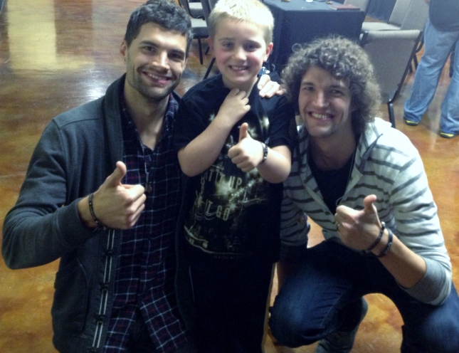 Alex Stauffer, middle, poses with Joel and Luke of for King and Country